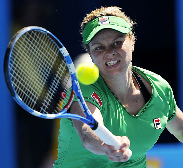 Kim Clijsters makes a forehand return to France's Alize Cornet during their third-round match.