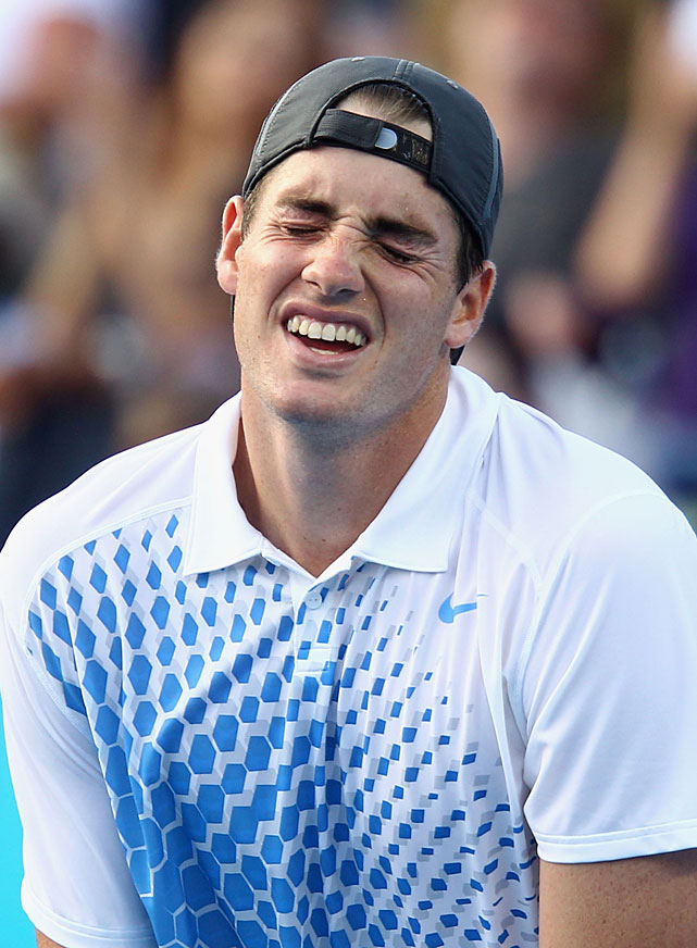 John Isner of the United States shows emotion after his 4-6, 6-2, 6-7(5), 7-6(2), 9-7 to Marin Cilic of Croatia.