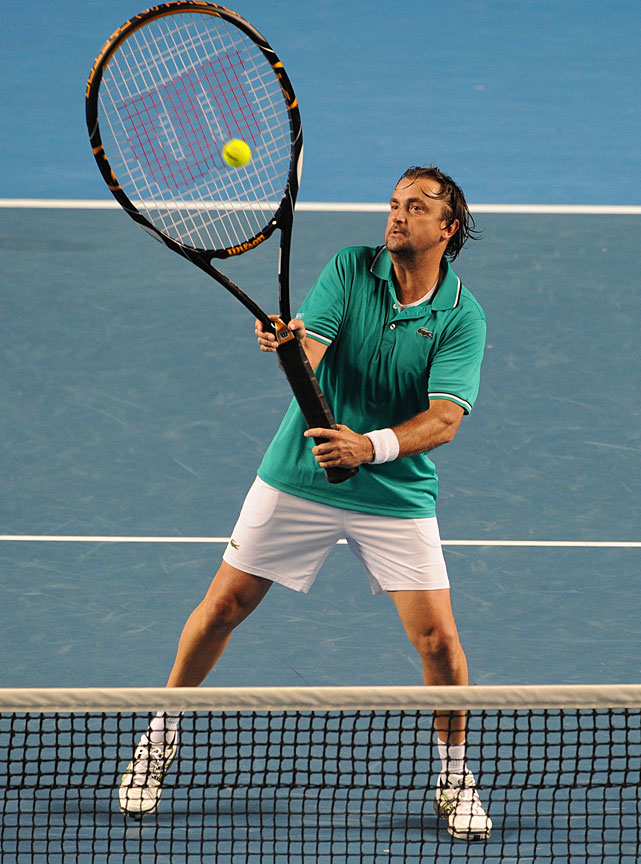 Henri Leconte of France plays a stroke with an oversize racket during a legends doubles exhibtion match.