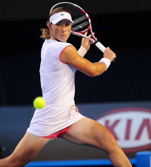 Stosur plays a backhand against Kvitova.