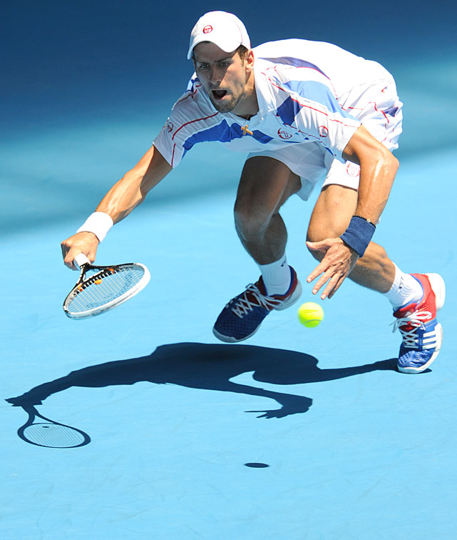 Novak Djokovic of Serbia plays a stroke during his fourth-round match against Nicolas Almagro of Spain. Djokovic won 6-3, 6-4, 6-0.