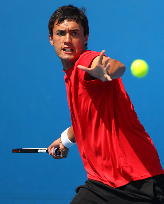 Jaden Grinter of New Zealand plays a forehand during his first-round juniors match against Dimitri Bretting of Switzerland.
