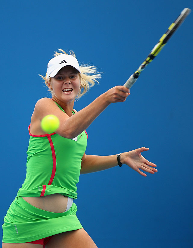 Ellen Allgurin of Sweden plays a forehand during her first-round juniors match against Yulia Putintseva of Russia.