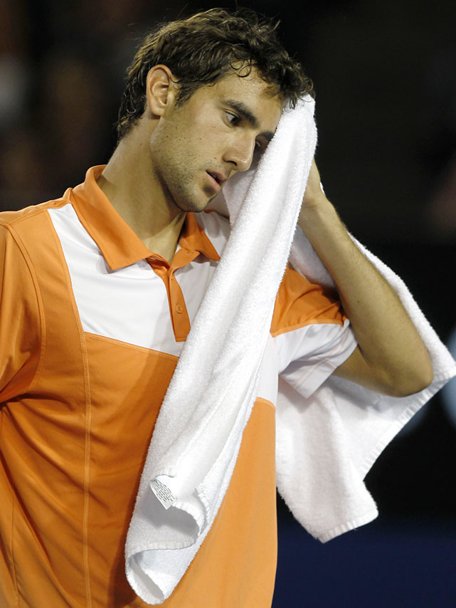 Cilic wipes his face during his fourth-round match with Nadal.