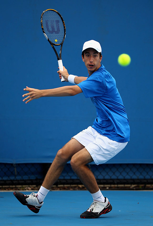 Nikola Milojevic of Serbia plays a forehand during his first-round juniors match against Chieh-Fu Wang of Chinese Taipei.