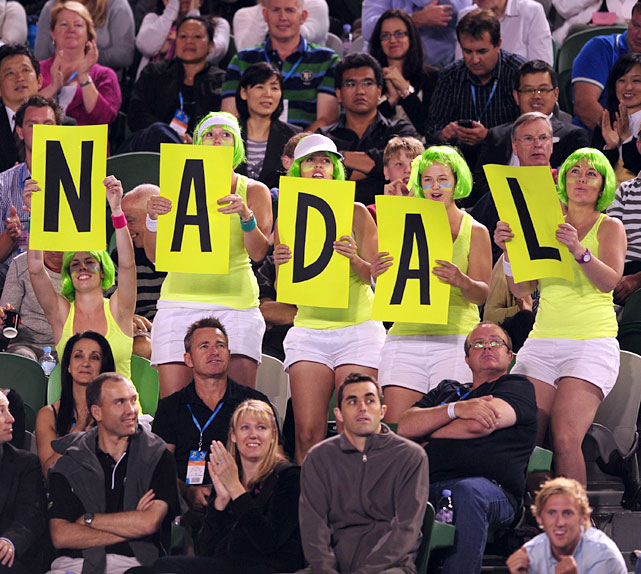 Nadal fans in the crowd show their support.