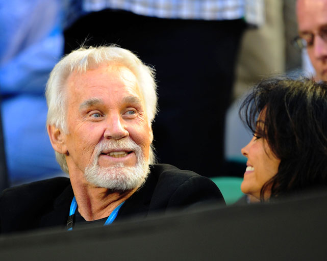 Country music legend Kenny Rogers watches the match between Nadal and Cilic on Monday night.