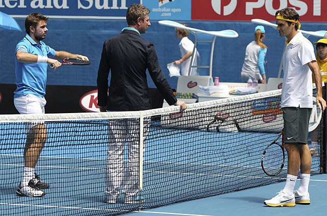 Switzerland's Roger Federer (right) and compatriot Stanislas Wawrinka (left) talk with chair umpire John Blom (center) before the start of their quarterfinal match.