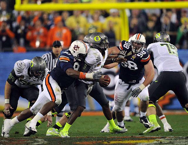 Auburn's swarming defense sacked Oregon quarterback Darron Thomas twice and forced a pair of interceptions.