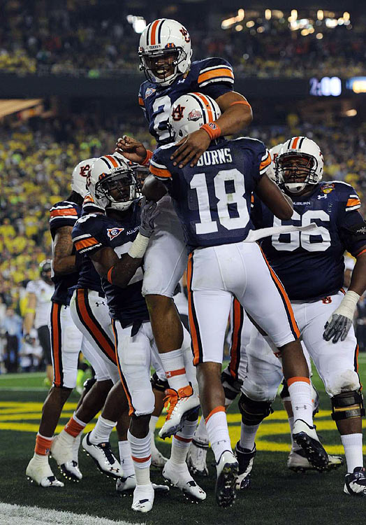 Cam Newton and Kodi Burns celebrate Auburn's initial touchdown, a 35-yard Newton-to-Burns scoring pass.