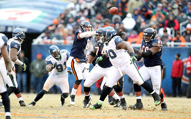 Jay Cutler ran for two touchdowns and threw for two as Chicago (12-5) pounded the Seahawks (8-10) from the outset, gliding through the snowflakes to score 21 first-half points. In his first postseason game, the ex-Vandy star showed none of the wild swings that often have marked his five-year career.