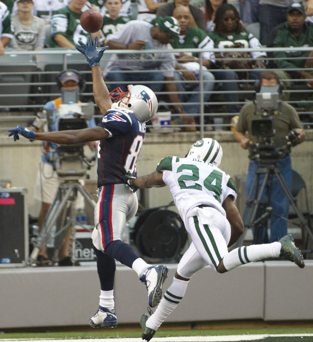 "Happy with his new contract, Darrelle Revis welcomed Randy Moss to Revis Island in Week 2. Moss didn't forget that Revis had called him a ""slouch,""and got revenge by making one of the more memorable receptions of 2010, a one-handed touchdown catch where he seemingly palmed the ball in midair."