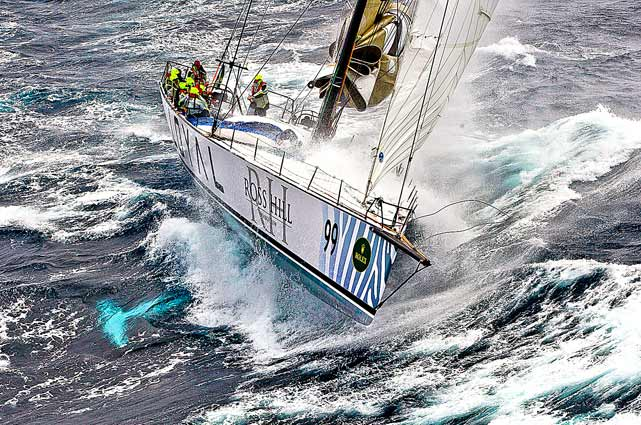 The crew of Australian vessel Loyal battled heavy seas in the Bass Strait during the 66th Sydney Hobart Yacht Race.