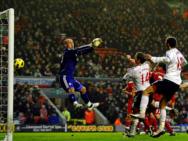 Bolton Wanderers' striker Kevin Davies scores the opening goal past Liverpool's Pepe Reina during the English Premier League football match at Anfield in Liverpool, England. Liverpool won 2-1.