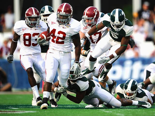 Alabama Crimson Tide running back Eddie Lacy breaks through the Michigan State defense for a touchdown during the third quarter of the Capital One Bowl in Orlando. Alabama defeated Michigan State 49-7.