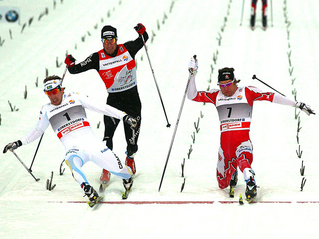 Emil Joensson of Sweden (left) wins the classic sprint ahead of Devon Kershaw of Canada and Dario Cologna of Switzerland at the FIS Cross Country World Cup Tour de Ski in Oberstdorf, Germany.