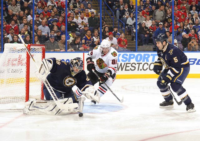 Tomas Kopecky of the Blackhawks shoots on St. Louis Blues goalie Ty Conklin during their Dec. 28 game at the Scottrade Center in St. Louis.The Blues defeated the Blackhawks 3-1.