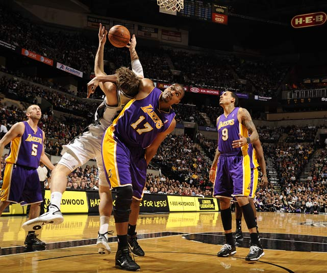 Lakers center Andrew Bynum fouls during a 97-82 loss to the Spurs on Dec 28, at the AT&T Center in San Antonio.