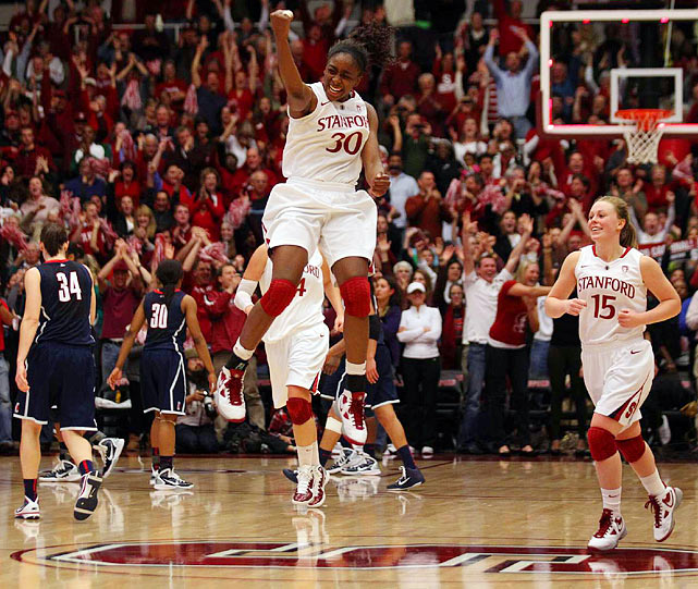 Stanford forward Nnemkadi Ogwumike celebrates with a leap of joy after a 71-59 upset of the UConn Huskies at the Maples Pavilion in Stanford, Calif. The victory ended the Huskies' 90-game winning streak.