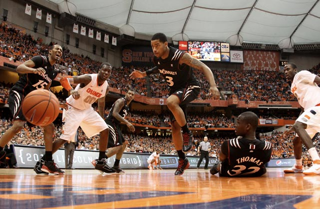 Cincinnati Bearcats guard Dion Dixon (3) goes after a rebound during a 67-52 loss to Syracuse at the Carrier Dome on Jan. 15.