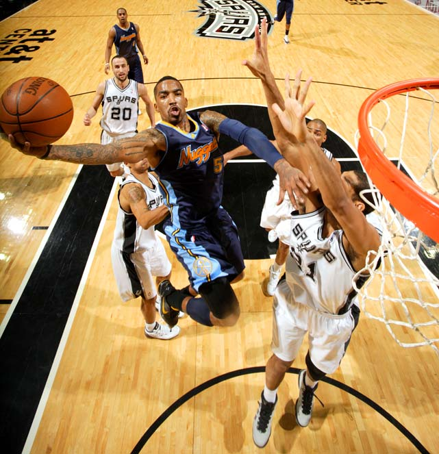 Denver's J.R. Smith shoots over Tim Duncan of San Antonio in a game won 110-97 by the Spurs on Jan. 16.