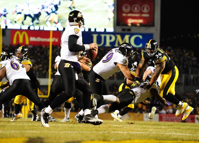 Lamarr Woodley of the Pittsburgh Steelers tries to sidestep a blocker to reach Baltimore quarterback Joe Flacco during the Steelers 31-24 divisional playoff win at Heinz Field on Jan. 15.