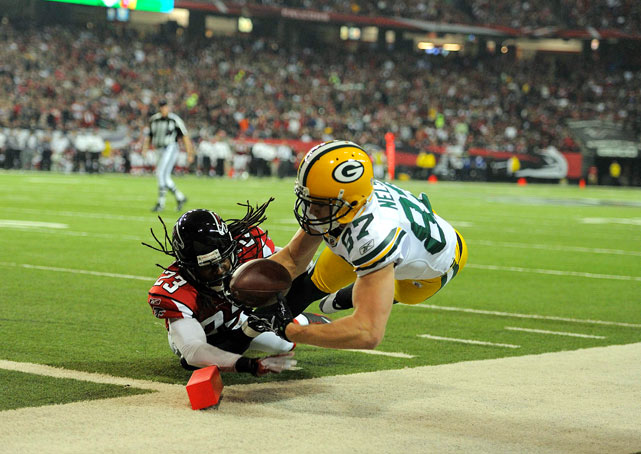 Jordy Nelson of the Green Bay Packers scores a touchdown against Atlanta's Dunta Robinson during the Falcons 48-21 loss in the divisional round of the NFL playoffs.