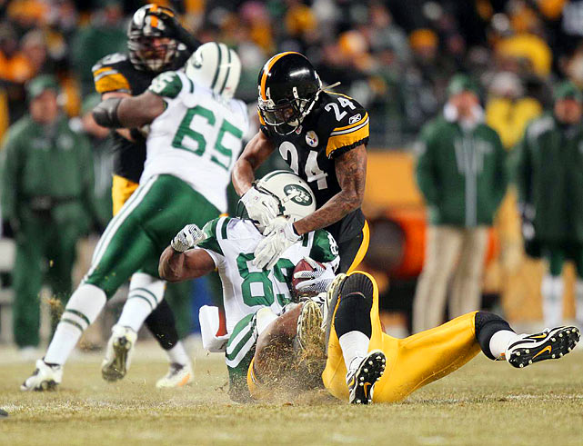 Ike Taylor (24) of Pittsburgh tackles New York Jets wide receiver Jerricho Cotchery (89) during the AFC Championship Game on Jan. 23 at Heinz Field in Pittsburgh. The Steelers defeated the Jets 24-19.