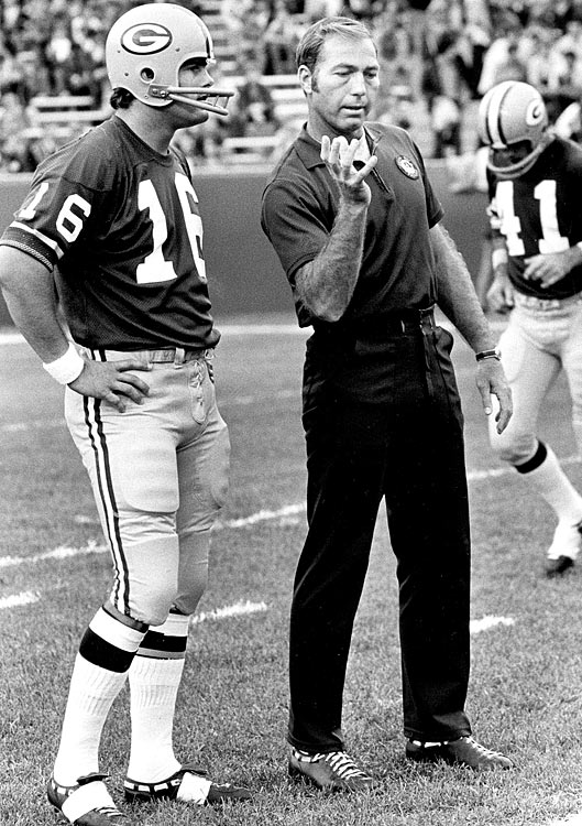 Packers quarterback Scott Hunter gets some tips from Starr before a 1972 game.