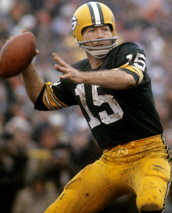 Two-time Super Bowl champion and Super Bowl MVP quarterback Bart Starr rears back to throw a pass.