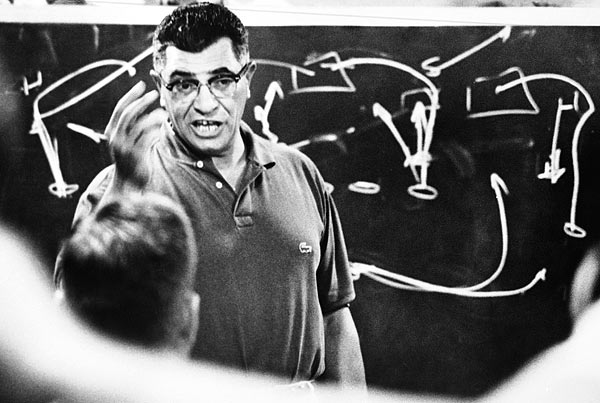 Lombardi addresses his players during a team meeting.