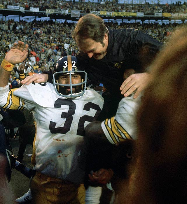 After winning the first of his eventual four championships, head coach Chuck Noll was carried off the field by Franco Harris (32) and Joe Greene. The Steelers beat the Minnesota Vikings 16-6 in Super Bowl IX on Jan. 12, 1975, at Tulane Stadium in New Orleans. Harris ran for 158 yards and was named MVP.