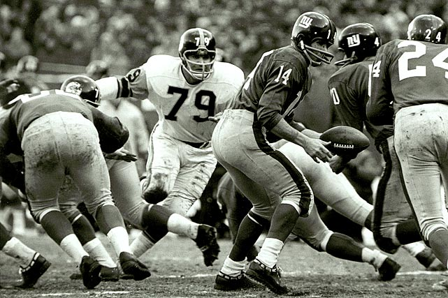 Before he was a lineman and kicker for the Colts, with whom he missed two field goal attempts in the 16-7 Super Bowl loss to Joe Namath and the Jets, Lou Michaels (79) helped hold down the middle for the Steelers. Here he works against the New York Giants in a 1963 game at Yankee Stadium.