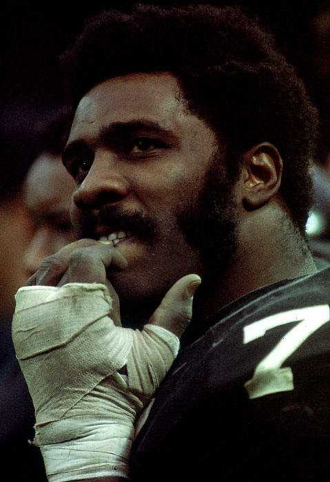 Mean Joe Greene bites his nails on the sidelines of a game against the Cleveland Browns on Nov. 25, 1973, at Municipal Stadium in Cleveland. Greene was selected to the All-Pro team five times, including the 1973 team, and won four Super Bowls as an anchor of the Pittsburgh defense.