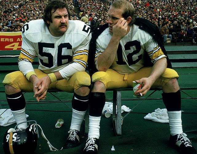 Steelers center Ray Mansfield (56) and quarterback Terry Bradshaw converse on the bench during a game against the San Francisco 49ers on Dec. 15, 1973, at Candlestick Park in San Francisco. The two played together from 1970 to '76 and won two Super Bowl titles in that period.