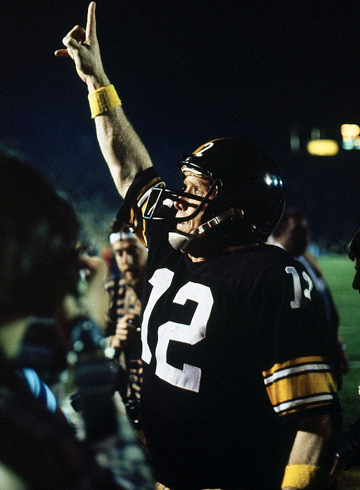 Quarterback Terry Bradshaw celebrates back-to-back titles after winning Super Bowl XIV at the Rose Bowl in 1980.  The Steelers beat the Rams 31-19 for their fourth championship in the 1970's.