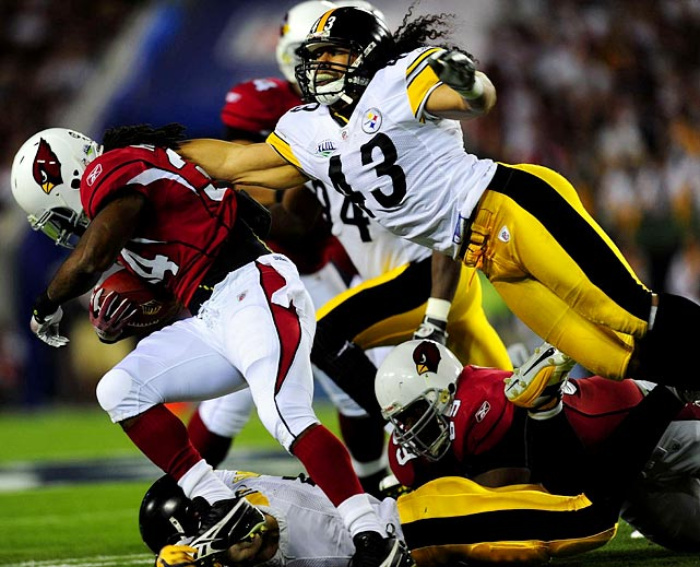 Safety Troy Polamalu leaps for a tackle of Arizona Cardinals running back Tim Hightower during Super Bowl XLIII at Raymond James Stadium in Tampa. The Steelers won 27-23, earning their sixth title.
