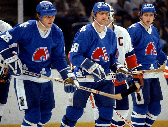 Spirited out of Communist Czechoslovakia with clandestine help from the Nordiques, the three defectors formed the NHL's first all-brother line since 1943, producing an average total of 99 goals and 257 points per season during their four years together in Quebec. Middle brother Peter became the first NHL rookie to score 100 points in a season (the first of his seven 100-point campaigns for the Nordiques) and later earned Hall of Fame enshrinement.