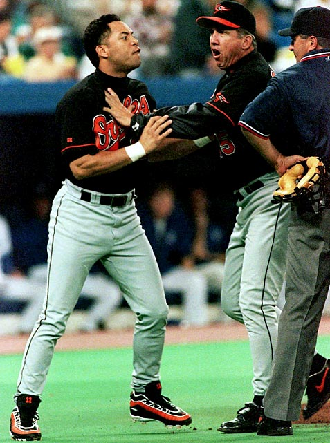 Alomar spent three seasons in his prime as a member of the Baltimore Orioles. He was elected to three All-Star games, won two gold gloves and was awarded a silver slugger. But Alomar might best be remembered for spitting on umpire John Hirschbeck. In this photo, Alomar is held back by manager Davey Johnson after getting ejected from the game over a called third strike.