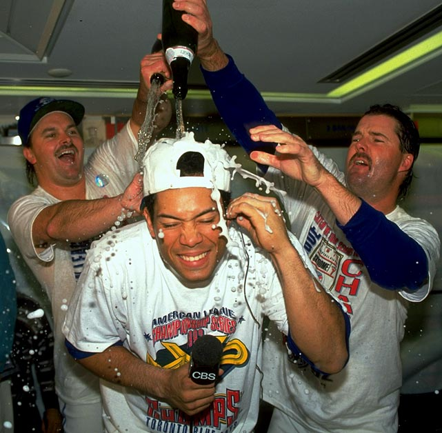 Alomar is doused with champagne by his Blue Jay teammates while he was being interviewed after a World Series clinching victory versus the Atlanta Braves in 1992. It was Alomar's first World Series win, and he played a significant role in getting Toronto there. He was the ALCS MVP thanks in large part to a Game 4, game-tying two-run home run in the ninth inning off Oakland Athletic closer Dennis Eckersley, which led to a pivotal Blue Jays win.