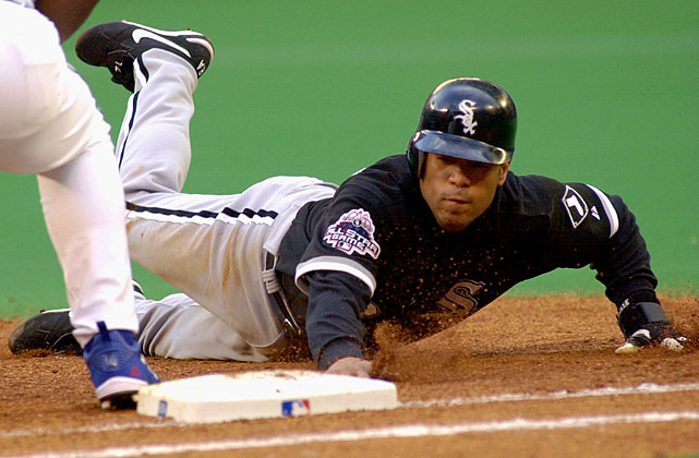 Alomar slides back to first to avoid a pickoff attempt in a 2003 game against the Toronto Blue Jays at the Sky Dome in Toronto. He was traded midseason to the White Sox and struggled toward the end of his career, hitting a career low .258 that year.
