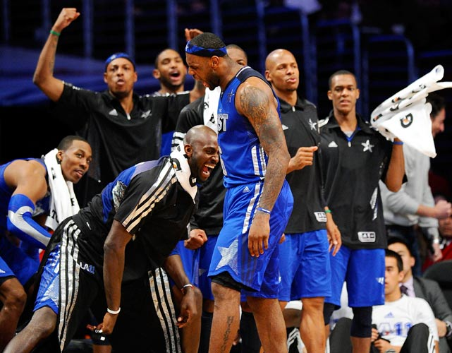 Who said no one cares about the All-Star game? The East's bench erupts after LeBron James converts the first half of an and-one Sunday.