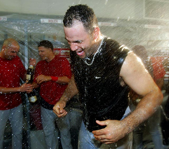 His biggest accomplishment through his first four seasons was leading the Cardinals to the 2004 World Series, where they were swept by the Red Sox. In this photo, Pujols is doused with champagne after the Cardinals' 6-2 win over the Dodgers to advance to the NLCS.