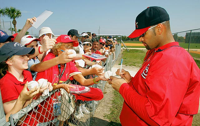 Pujols signs autographs after a spring training workout. The first baseman already holds a number of team records and is arguably the franchise's most popular player since Stan Musial.