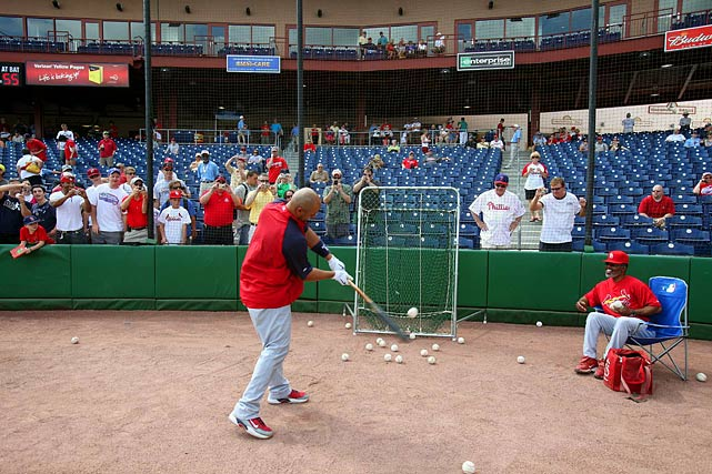 Pujols, who has accumulated 1,900 career hits, works on his form before a game against the Reds.