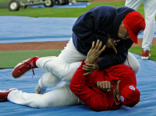 Pujols gets tackled by Ronnie Belliard before Game 3 of the 2006 World Series. The first baseman batted .331 with 49 home runs and 137 RBIs in leading the Cardinals to their first World Series victory since 1982.