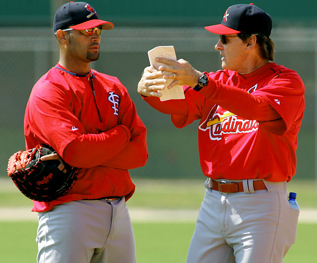 Pujols talks to Cardinals manager Tony La Russa, who has been the only manager the first baseman has played for since entering the big leagues in 2001.