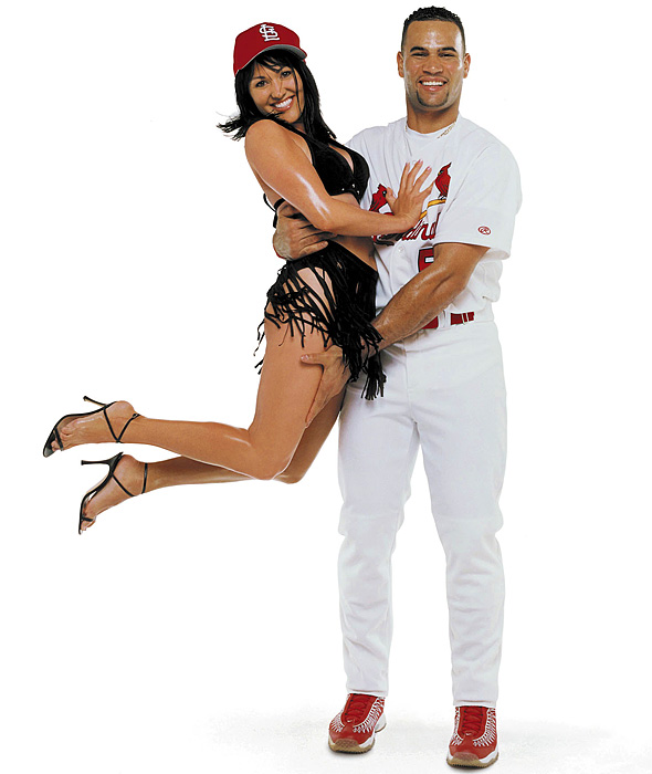 Pujols made an instant splash, batting .329 and winning the 2001 Rookie of the Year award. By 2002, Pujols had established himself as one of the game's top young players. He also took time to pose in the 2002 SI Swimsuit issue with his wife, Deidre.