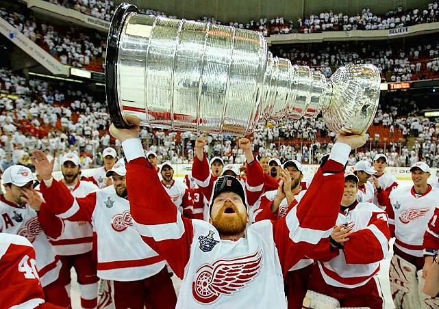 """Four-time Stanley Cup-winner Kris Draper hung up his skates on July 26 after 20 seasons in the NHL. Draper started his career with the Winnipeg Jets, but his national profile skyrocketed after the Detroit Red Wings acquired him on waivers for one dollar in 1993. He never put up huge stats, but the speedy, hard-working center was one of the most consistent and durable players in Wings history. Along with Kirk Maltby and Darren McCarty, Draper was a member of the """"Grind Line,"""" a unit beloved in Detroit for its blue collar ethic. When Colorado's Claude Lemieux injured Draper with an infamous cheapshot during the 1996 Western Conference Finals, it sparked the NHL's most ferocious rivalry of the late 1990s and catalyzed the Red Wings into the league's most successful team of the ensuing 13 seasons. A face-off specialist and tenacious checker, Draper won the 2004 Selke Trophy as the NHL's best defensive forward. In 2009, he became the fifth player to play 1,000 games with the Red Wings."""