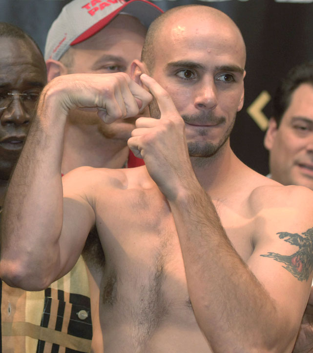 Pavlik gestures during the weigh-in for the first of his two fights with Jermain Taylor.